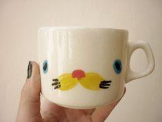 Hand made ceramic Teacup.  via Etsy.