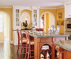 love the warm island and then white cabinets with the dark floor and YELLOW! :)