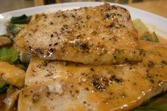 Foil baked mahi mahi. Olive oil.  Top with scallions, tsp. of white wine or cider, salt, pepper, pat of butter.  Lemon wedge if desired.  wrap in foil, bake 25 mins at 400 degrees.