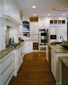 This elegant sandy-brown granite sets off the white cabinets nicely and allows the tan countertop to blend throughout the kitchen!