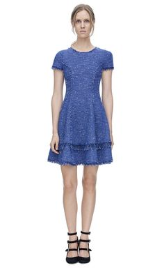 Stretch tweed fit and flare dress with metallic accents & frayed fringe details throughout. Slim fit, bodice to hip with a flounce hem. Exposed back zip.