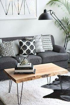 Dark grey lounge - light timber, light grey rug, greenery - white walls
