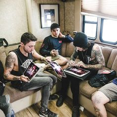 I like this picture because it looks very natural and has the band together doing some signings.