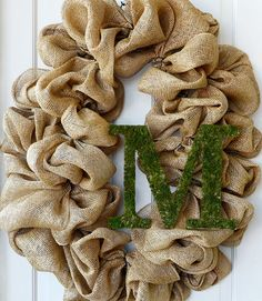Personalize a burlap wreath with a mossy monogram. Cover a wooden letter with green sheet moss for a fresh spring look. Get the tutorial at Mardi Gras Outlet   - CountryLiving.com