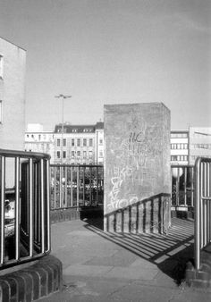 The monument after many years have passed now covered in love hearts, names, slogans, swastikas, scratches. Jochen Gerz and Esther Shalev-Gerz's Monument against Fascism (2). Hamburg-Harburg, Germany 1986.