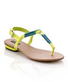 A barely-there sandal gets a sun-soaked update with a vivid neon hue and a contrast teal detail.Buckle closurePatent / man-made upperMan-made soleImported