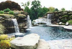 my pool will also have a bar you can swim right up to and enjoy a beverage and be connected to a hot tub Swimming Pool Waterfall, Swimming Pool Landscaping, Natural Swimming Pools, Swimming Pool Designs, Backyard Landscaping, Landscaping Ideas, Pool Water Features, Waterfall Features, My Pool