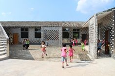 Mulan Primary School / Rural Urban Framework // lovely brickwork + courtyard integration
