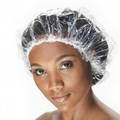 Black woman wearing plastic cap over her hair