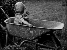 I just love pictures of kids.  And riding in the wheelbarrow is such a kid thing to do!