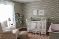 Adorable Baby Nursery with a stenciled feature wall   Wonderment Trellis Wall Stencil   Royal Design Studio wall stencils for kids rooms and girls rooms and wallpaper look
