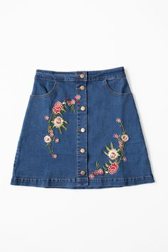 - Gorgeous floral embroidered denim skirt - Button up front - High waistline - Front side pockets - Stretchy cotton denim - 98% Cotton 2% Spandex - Imported