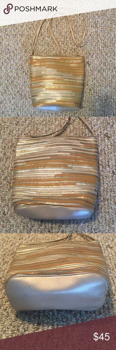 "NWOT Sharif Made in USA shoulder bag 100% leather Fun and trendy NWOT Sharif made in the USA 100% genuine leather handbag in a beautiful blend of  gold, silver and antiqued gold colored leather. Dimensions taken while garment is laying flat: 9.5"" long x 8"" tall x 4"" wide. Shoulder strap is 44 inches long with a 21 inch drop. Sharif Bags Shoulder Bags"