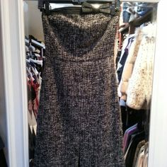 Express Size 2 Tweed Dress New with tags size 2 Express strapless black & white tweed dress. It has a cute bow on the chest area and is a really nice length. On me, it falls below the knee. It is too big on me or I would keep it. Express Dresses