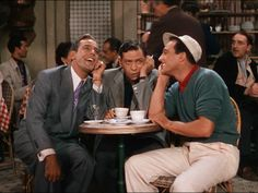 """A funny trio at the cafe in An American in Paris 1951: George Guetary playing Henry Baurel, Oscar Levant playing Adam Cook, and Gene Kelly playing Jerry Mulligan. Henry and Jerry just start to sing """"'S Wonderful"""" while Adam's face responds with the irony of the particular situation."""