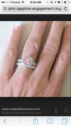 My ring pink sapphire with halo diamonds around it!