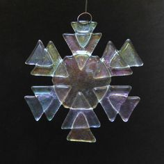 BRISK Iridized Fused Glass Snowflake Ornament Suncatcher. $15.00, via Etsy.