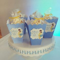 Baby shower dessert table. Desserts included: Cake, Cupcakes, Cake Pops, Homemade Chocolate Lollipops and Ready to POP popcorn boxes. Banner, tags and popcorn boxes were custom cut by our die cutting machine and all dessert stands are available for rent. www.dolcerellabakery.ca