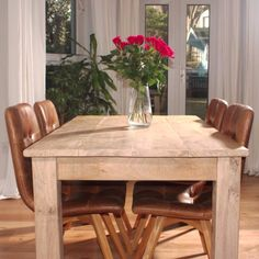 Rustic Oak Farmhouse Dining Table with Leather Chairs