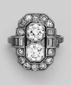Diamond Ring   Platinum, 2 old European-cut diamonds ap. 1.25 cts., 20 diamonds ap. .95 ct., c. 1920