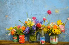 Repurpose cans and glass bottles as vases from our friends at Frolic | DunnDIY.com | #inspiration