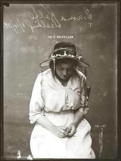 """vintage mug shot from Sydney, Australia in the 1920s. 'What is she thinking?"""" or """"What is she doing?"""""""