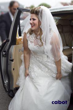 Bride looking amazing in a Rolls Royce Phantom