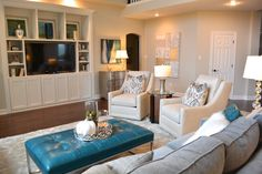 The teal leather ottoman makes a statement in this living room.