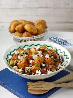 Warm Cyprus potato and tomato salad with feta and oregano.