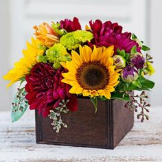 HGTV Gardens shares photos of beautiful flower arrangements featuring fall mums. Flower Arrangement Designs, Unique Flower Arrangements, Unique Flowers, Fall Flowers, Beautiful Flowers, Orchid Flowers, Wedding Arrangements, Sunflower Centerpieces, Sunflower Arrangements