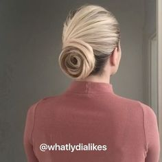 🌹classic Rose bun 🌹#hairtutorial #hair #hairvideo #rosebun  Use the first twist bun as a base then take small sections and wrap them around and around to form the different layers. Pin each section in place. Use hairspray to make the hair more manageable and tame fly aways 💗