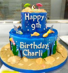This beach birthday 2-tier is going from the beach to under the sea!