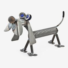 Handcrafted in Kentucky, this lovable Spring Dachshund is made using scrap and reject metal, and features colored glass marble eyes. These quintessentially cute critters make the ultimate gift for the