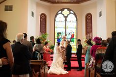The beautiful stained glass provides a beautiful backdrop for your ceremony. :) #weddings David and Amy Lau Photography