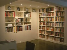 Home library with storage closet.