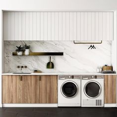 Laundry inspo! Marble splash back, timber cabinetry below, white wall hung cupboards