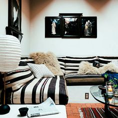 Dark stripes on cushions keep black from taking over the room.