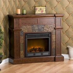 @Overstock.com.com - This fireplace features a rich espresso finish and sleek columns that compliment the crown molding. This mantel also has a hinged panel for use in a corner or along a flat wall.http://www.overstock.com/Home-Garden/Hollandale-Espresso-Electric-Fireplace/5389328/product.htm