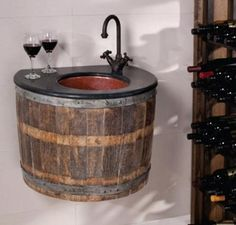 old wine barrels...cute for a guest bathroom.... or bar set up