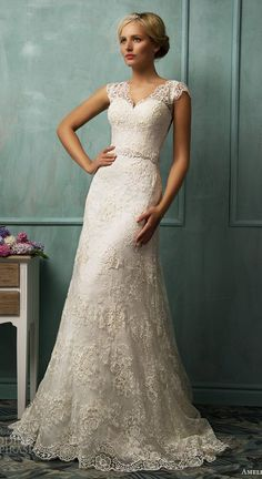 I would at least love to try this lace wedding dress