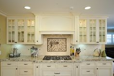 Custom hood and glass-front cabinets - traditional - kitchen - san francisco - The Wood Connection