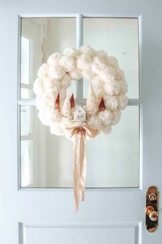 Winter Pom Pom Wreath DIY Make this cozy winter wreath in 4 easy steps. Anthropologie inspired DIY w Navidad Simple, Navidad Diy, Pom Pom Wreath, Diy Wreath, Wreath Ideas, Snowflake Wreath, Wreath Crafts, Pom Pom Tree, Floral Wreath