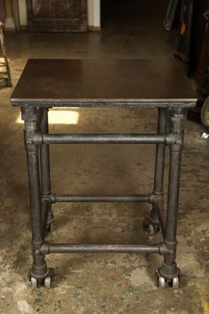 1stdibs.com   Cast Iron Industrial Table with Dual Wheels