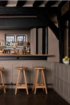 chamfered panel   dining-rooms-dark-wood-counter-stools-exposed-beams-open-shelving-restaurants