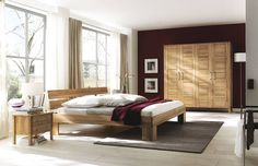 """Tranquil, feng shui bedroom with spacious, tranquil vibe and woden bed, bdside table and wardrobe. So chill. Drehtüren-Kleiderschrank """"Molara 01"""". Wardrobes & closets by Allnatura"""