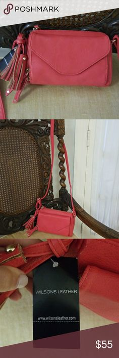 Wilson's Leather Coral Cross Body Beautiful coral color. Perfect for the summer!  Has 3 seperate compartments. Very convenient to carry things Wilsons Leather Bags