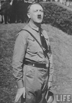 Hitler was in a brown Nazi uniforms during a speech outdoors in Austria. 1938