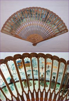 """c1900, a lovely bamboo brise Japanese fan, made to give a """"stained glass"""" effect.  The oar-shaped sticks are very thin and light. At the wide ends of the """"oars,"""" the centers were cut out;  each window was then carefully covered from the back with a sliver of translucent silk.  The silk was then hand painted, in this case with a courtly scene in a garden."""