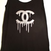 This super dope tank features a Chanel drip logo embellished with glitter. The tank is flowy and loose- perfect with a bandeau!
