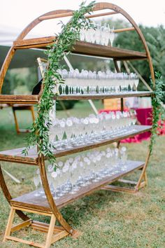 One of our faves! This round wooden arbor features 4 rows of shelving and endless possibilities - like a champagne pick Diy Wedding, Rustic Wedding, Dream Wedding, Wedding Day, Wedding Lounge, Wedding Rentals, Wedding Venues, Wedding Arbors, Event Design
